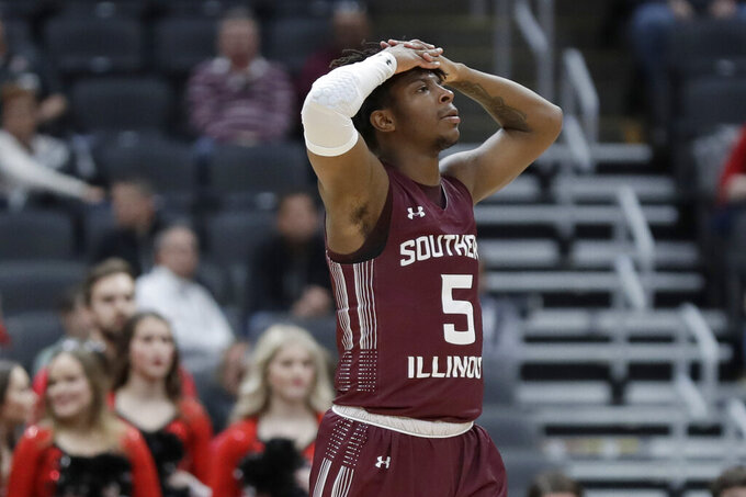 Southern Illinois' Lance Jones reacts to a call during the second half of an NCAA college basketball game against Bradley in the quarterfinal round of the Missouri Valley Conference men's tournament Friday, March 6, 2020, in St. Louis. (AP Photo/Jeff Roberson)