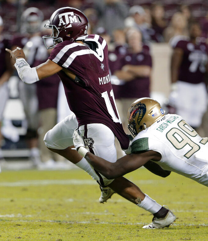 Texas A&M quarterback Kellen Mond (11) is caught on a keeper play by UAB defensive lineman Jamell Garcia-Williams (99) during the second half of an NCAA college football game Saturday, Nov. 17, 2018, in College Station, Texas. (AP Photo/Michael Wyke)
