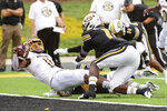Central Michigan wide receiver JaCorey Sullivan, left, scores a touchdown past Missouri's Devin Nicholson, right, during the first half of an NCAA college football game Saturday, Sept. 4, 2021, in Columbia, Mo. (AP Photo/L.G. Patterson)
