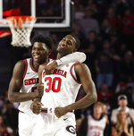 Georgia's Anthony Edwards (5) celebrates with Mike Peake (30), who drew a charge on an Alabama player during an NCAA college basketball game Saturday, Feb. 8, 2020, in Athens, Ga. (Kristin M. Bradshaw/Athens Banner-Herald via AP)