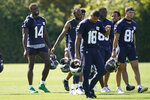 Seattle Seahawks wide receiver DK Metcalf (14) laughs as he walks with teammates on the last day of NFL football training camp for the team, Thursday, Sept. 3, 2020, in Renton, Wash. (AP Photo/Ted S. Warren)