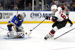 St. Louis Blues goaltender Jordan Binnington (50) stops a shot by Arizona Coyotes' Lawson Crouse (67) during the third period of an NHL hockey game Tuesday, Nov. 12, 2019, in St. Louis. The Coyotes won 3-2 in a shootout. (AP Photo/Jeff Roberson)