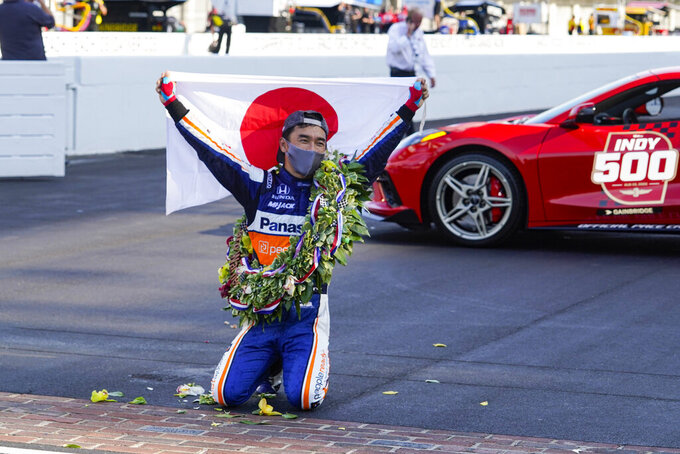 Takuma Sato, of Japan, celebrates after winning the Indianapolis 500 auto race at Indianapolis Motor Speedway in Indianapolis, Sunday, Aug. 23, 2020. (AP Photo/Michael Conroy)