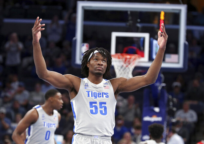 Memphis forward Precious Achiuwa (55) reacts after making a shot in the first half of an NCAA college basketball game against Bradley Tuesday, Dec. 3, 2019, in Memphis, Tenn. (AP Photo/Karen Pulfer Focht)