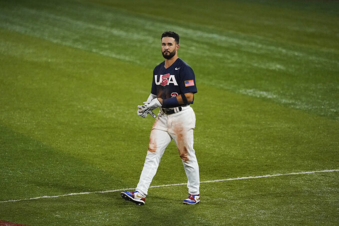 United States' Eddy Alvarez walks to the dugout after grounding out in the fifth inning of the gold medal baseball game against Japan at the 2020 Summer Olympics, Saturday, Aug. 7, 2021, in Yokohama, Japan. (AP Photo/Jae C. Hong)