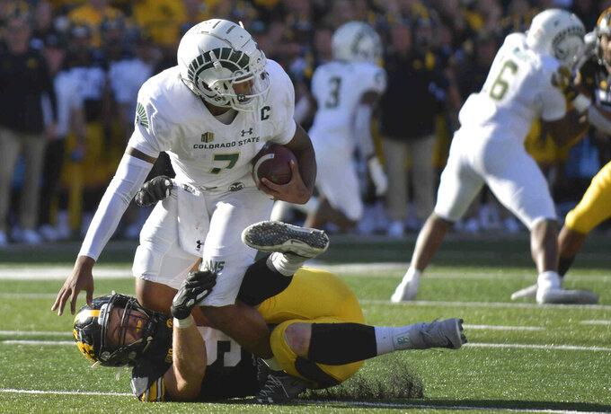 Iowa defensive lineman Lukas Van Ness (91) tackles Colorado State quarterback Todd Centeio (7) during the second half of an NCAA college football game, Saturday, Sept. 25, 2021, in Iowa City, Iowa. (AP Photo/Ron Johnson)