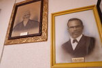 This Jan. 2, 2021 photo shows portraits of Old Mount Zion Baptist Church's first two pastors, the Rev. Ned Starks and the Rev. James Foster Marshall, hang in the church library.  (Damian Dominguez/The Index-Journal via AP)