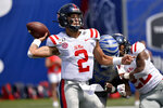 Mississippi quarterback Matt Corral (2) throws a pass in the first half of an NCAA college football game against Memphis, Saturday, Aug. 31, 2019, in Memphis, Tenn. (AP Photo/Brandon Dill)