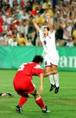 FILE - In this Thursday, Aug. 1, 1996, file photo, Tiffeny Milbrett of the U.S. Olympic soccer team reacts after scoring the goal that won the gold medal for the U.S. against China  at Sanford Stadium in Athens, Ga. The U.S. beat China 2-1.(AP Photo/Joe Cavaretta, File)