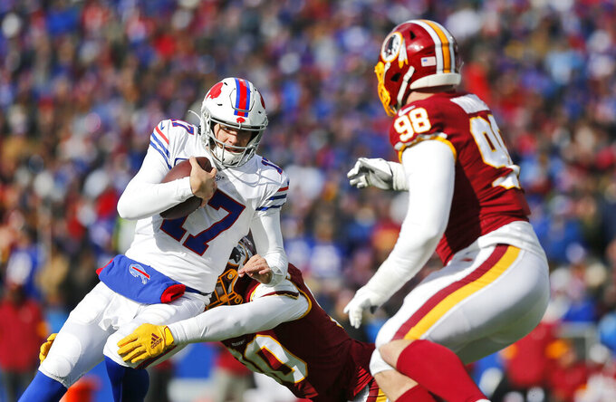 Buffalo Bills quarterback Josh Allen (17) rushes against the Washington Redskins during the first half of an NFL football game, Sunday, Nov. 3, 2019, in Orchard Park, N.Y. (AP Photo/John Munson)