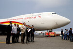 Industry and National Production Minister Tareck El Aissami speaks to reporters next to a Chinese airplane at the Simon Bolivar International Airport in Maiquetia, near Caracas, Venezuela, Friday, March 29, 2019. Aid was unloaded from the plane in what Venezuelan officials said would be the first delivery of many from China, an ally of the government of President Nicolas Maduro. (AP Photo/Natacha Pisarenko)