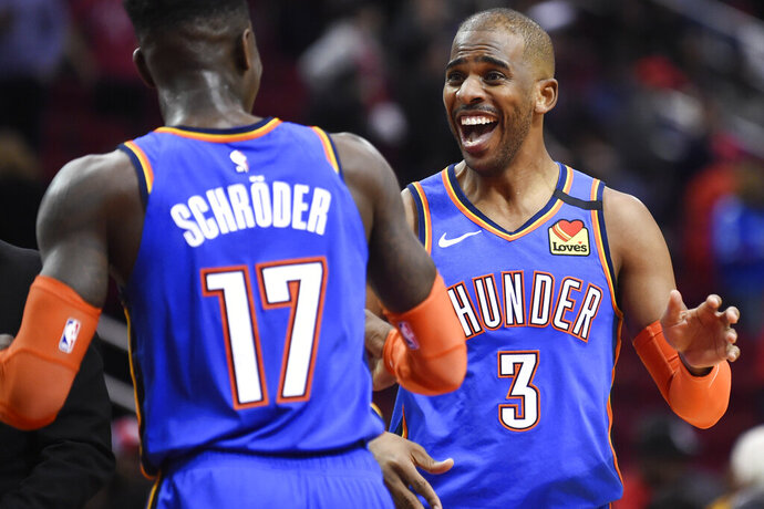 Oklahoma City Thunder guard Chris Paul (3) celebrates the team's win with guard Dennis Schroder in an NBA basketball game against the Houston Rockets, Monday, Jan. 20, 2020, in Houston. (AP Photo/Eric Christian Smith)