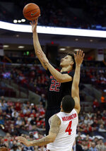 Rutgers guard Caleb McConnell, left, goes up for a shot against Ohio State guard Duane Washington during the first half of an NCAA college basketball game in Columbus, Ohio, Saturday, Feb. 2, 2019. (AP Photo/Paul Vernon)