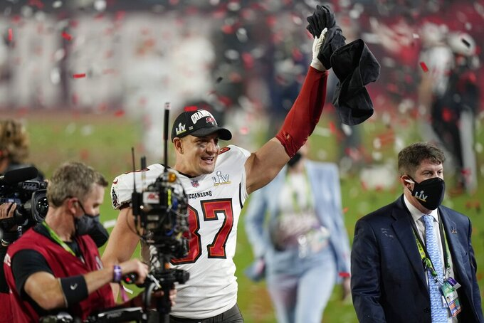 Tampa Bay Buccaneers tight end Rob Gronkowski celebrates after defeating the Kansas City Chiefs in the NFL Super Bowl 55 football game Sunday, Feb. 7, 2021, in Tampa, Fla. The Buccaneers defeated the Chiefs 31-9 to win the Super Bowl. (AP Photo/Ashley Landis)