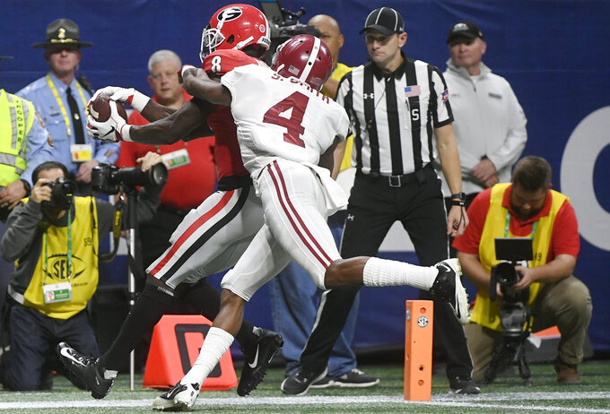 Georgia wide receiver Riley Ridley (8) makes a touchdown catch against Alabama defensive back Saivion Smith (4) during the second half of the Southeastern Conference championship NCAA college football game, Saturday, Dec. 1, 2018, in Atlanta. (AP Photo/John Amis)