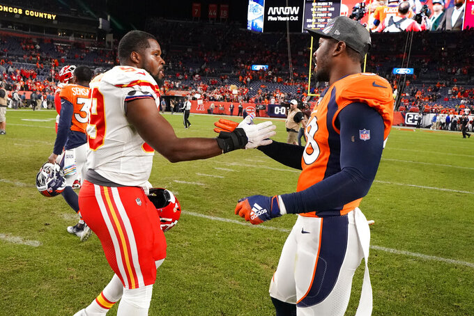 Denver Broncos outside linebacker Von Miller, right, greets Kansas City Chiefs inside linebacker Reggie Ragland after an NFL football game, Thursday, Oct. 17, 2019, in Denver. The Chiefs won 30-6. (AP Photo/Jack Dempsey)