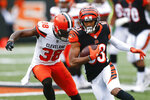 FILE - In this Sunday, Nov. 25, 2018 file photo, Cincinnati Bengals wide receiver Tyler Boyd (83) runs the ball against Cleveland Browns defensive back T.J. Carrie (38) in the second half of an NFL football game in Cincinnati. Receiver Tyler Boyd signed a four-year contract extension on Tuesday, July 23, 2019 coming off his breakthrough season with the Cincinnati Bengals.(AP Photo/Gary Landers, File)