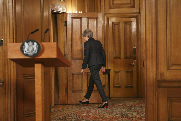 Britain's Prime Minister Theresa May leaves after making a statement, at 10 Downing Street, in London, Wednesday, March 20, 2019. May says it's a matter of