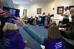 Ricky Hurtado, a Democratic candidate for the North Carolina state house, right, talks to volunteers before they head out to canvass voters, in Mebane, N.C., Sunday, March 8, 2020. (AP Photo/Jacquelyn Martin)