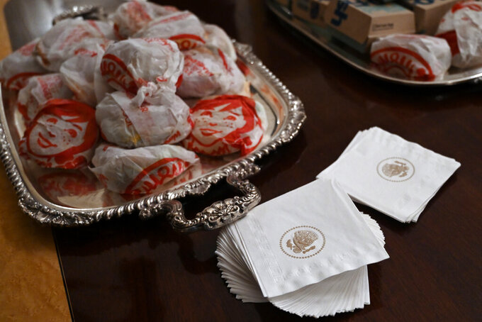 A the table full of fast food in the State Dining Room of the White House in Washington, Monday, Jan. 14, 2019, is ready for guests attending a reception for the Clemson Tigers. (AP Photo/Susan Walsh)
