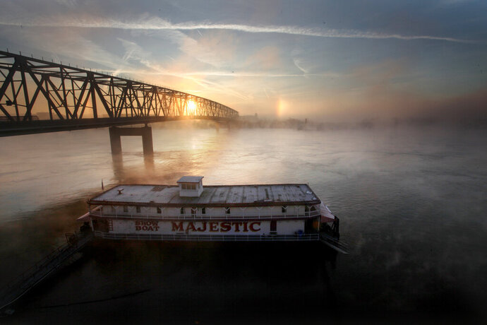 FILE - In this Nov. 29, 2011, file photo, the Showboat Majestic is docked at the Public landing in Cincinnati as fog rolls off the Ohio River. The new owners of Cincinnati's historic Showboat Majestic plan to continue using the double-decker riverboat as an entertainment venue at a different point on the Ohio River. (Carrie Cochran/The Cincinnati Enquirer via AP, File)