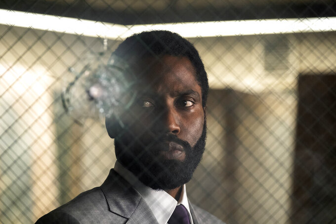 """This image released by Warner Bros. Entertainment shows John David Washington in a scene from """"Tenet."""" (Melinda Sue Gordon/Warner Bros. Entertainment via AP)"""