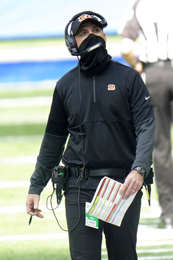 Cincinnati Bengals head coach Zac Taylor looks on during the first half of an NFL football game against the Indianapolis Colts, Sunday, Oct. 18, 2020, in Indianapolis. (AP Photo/AJ Mast)