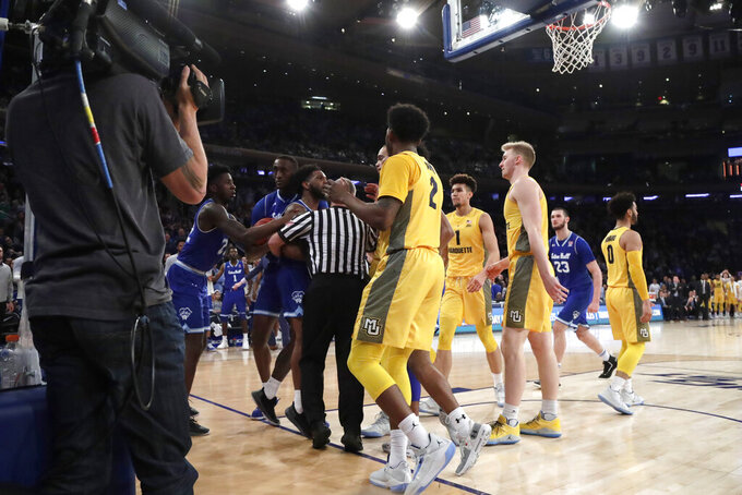 Seton Hall players, left, argue with Marquette players during the second half of an NCAA college basketball semifinal game in the Big East men's tournament, Friday, March 15, 2019, in New York. Seton Hall won 81-79. (AP Photo/Julio Cortez)