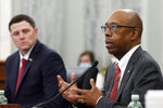 National Collegiate Athletic Association Board of Governors Chairman Dr. Michael Drake, right, testifies before a Senate Commerce Committee hearing on Capitol Hill in Washington, Wednesday, July 1, 2020. University of Mississippi Vice Chancellor for Intercollegiate Athletics Keith Carter, left, listens. The hearing is looking at the National Collegiate Athletic Association Board of Governors' recent report on student-athlete compensation and the modernization of rules related to name, image, and likeness commercialization. (AP Photo/Susan Walsh)