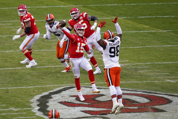 Kansas City Chiefs quarterback Patrick Mahomes (15) throws a pass over Cleveland Browns defensive tackle Sheldon Richardson (98) during the first half of an NFL divisional round football game, Sunday, Jan. 17, 2021, in Kansas City. (AP Photo/Orlin Wagner)
