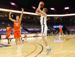 Virginia forward Sam Hauser (10) shoots next to Syracuse guard Buddy Boeheim (35) during an NCAA college basketball game Monday, Jan. 25, 2021, in Charlottesville, Va. (Andrew Shurtleff/The Daily Progress via AP)