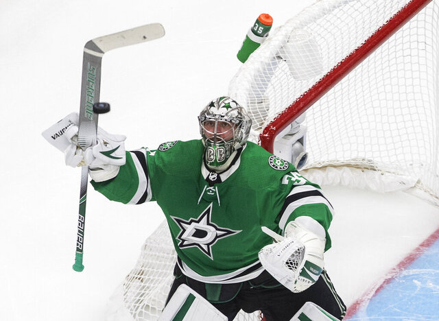 Dallas Stars goalie Anton Khudobin bats the puck out of the air during the second period against the Vegas Golden Knights in Game 4 of the NHL hockey Western Conference final, Saturday, Sept. 12, 2020, in Edmonton, Alberta. (Jason Franson/The Canadian Press via AP)