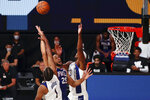 Philadelphia 76ers guard Ben Simmons (25) shoots against Indiana Pacers center Myles Turner (33) and forward T.J. Warren (1) during the fourth quarter of an NBA basketball game Saturday, Aug. 1, 2020, in Lake Buena Vista, Fla. (Kim Klement/Pool Photo via AP)