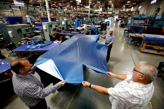 FILE - In this July 5, 2018, file photo workers assemble the Afloat water mattresses at the factory in Corona, Calif. On Wednesday, May 15, 2019, the Federal Reserve reports on U.S. industrial production for April. (AP Photo/Chris Carlson, File)