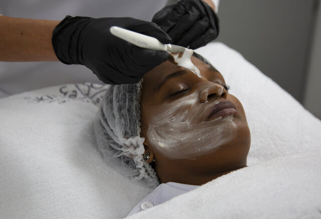 "A skin lightening mask is applied to the face during a demonstration for the Associated Press Tuesday, July 7, 2020, at the Skin and Body International Centre in Lenasia, Johannesburg. For years, cosmetics giants Unilever and L'Oreal have marketed skin whitening creams to women across the globe with less-than-subtle ads promoting ""fair skin"" as more desirable than naturally darker shades. In the wake of mass protests against racial injustice in the U.S., these corporations are re-branding their skin lightening products in Africa, Asia and the Middle East, but for generations of women raised on their messaging, the new marketing is unlikely to reverse deeply rooted prejudices around ""colorism"", the idea that fair skin is better than dark skin. (AP Photo/Denis Farrell)"