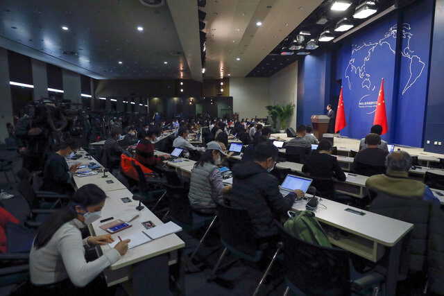 Chinese Foreign Ministry spokesman Geng Shuang speaks during a daily briefing at the Ministry of Foreign Affairs office in Beijing, Wednesday, March 18, 2020. At least 13 American journalists stand to be expelled from China in retaliation for a new limit imposed by the Trump administration on visas for Chinese state-owned media operating in the U.S. (AP Photo/Andy Wong)