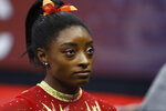 FILE - In this July 28, 2018, file photo, Olympic champion Simone Biles talks with her coach before the start of the U.S. Classic gymnastics competition in Columbus, Ohio. Biles says she's struggling with the arrest of her brother who was charged in a shooting that left three dead. She said in a tweet Monday, Sept. 2, 2019, that her heart aches for everyone involved, especially the victims and their families. (AP Photo/Jay LaPrete, File)