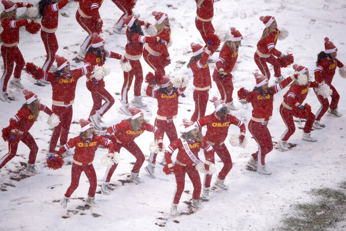 Kansas City Chiefs cheerleaders perform in the snow during the second half of an NFL football game against the Denver Broncos in Kansas City, Mo., Sunday, Dec. 15, 2019. (AP Photo/Charlie Riedel)