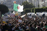 Algerian demonstrators take to the streets in to protest against the government and the upcoming presidential elections, inAlgiers, Algeria, Friday, Nov.29, 2019. Thousands of protesters took to the streets of the capital after Friday prayers. (AP Photo/Toufik Doudou)