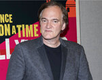 """FILE - This April 24, 2018 file photo shows Quentin Tarantino at CinemaCon in Las Vegas, Nev. Tarantino's  """"Once Upon a Time in Hollywood"""" was announced as a late addition to the Cannes Film Festival on Thursday. It will premiere in competition at the upcoming French festival, adding one of the summer's starriest, most anticipated films to Cannes' red carpet. (Photo by Eric Jamison/Invision/AP, File)"""