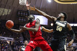 Rutgers forward Akwasi Yeboah (1) shoots in front of Purdue forward Trevion Williams (50) during the first half of an NCAA college basketball game in West Lafayette, Ind., Saturday, March 7, 2020. (AP Photo/Michael Conroy)