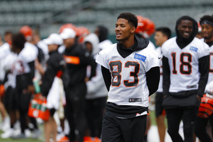 FILE - In this June 12, 2019 file photo Cincinnati Bengals wide receiver Tyler Boyd (83) participates during practice at the team's NFL football facility in Cincinnati. Receiver Tyler Boyd signed a four-year contract extension on Tuesday, July 23, 2019 coming off his breakthrough season with the Cincinnati Bengals. (AP Photo/John Minchillo, File)