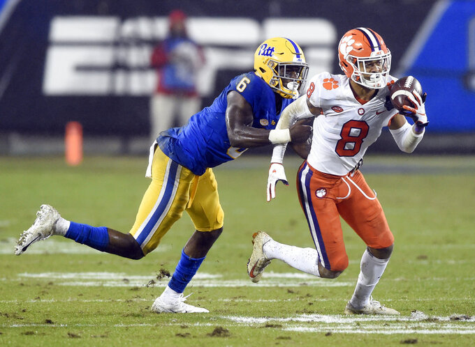 Clemson's A.J. Terrell (8) returns an interception against Pittsburgh's Aaron Mathews (6) in the first half of the Atlantic Coast Conference championship NCAA college football game in Charlotte, N.C., Saturday, Dec. 1, 2018. (AP Photo/Mike McCarn)