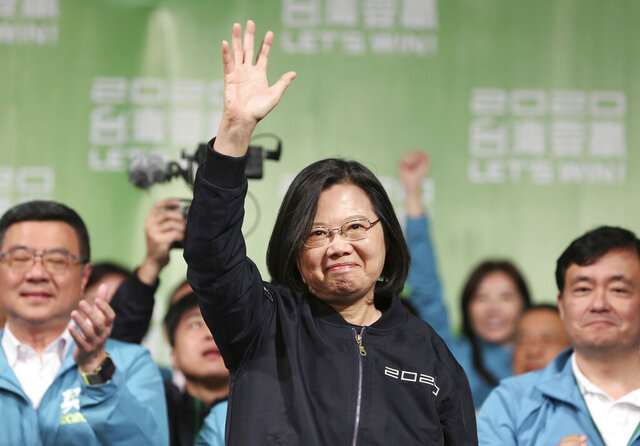 FILE - In this Jan. 11, 2020, file photo, Taiwanese President Tsai Ing-wen celebrates her victory with supporters in Taipei, Taiwan. President Tsai on Monday is calling on China to release all information about the outbreak of a new virus and work with the island on curbing its spread.  (AP Photo/Chiang Ying-ying, File)