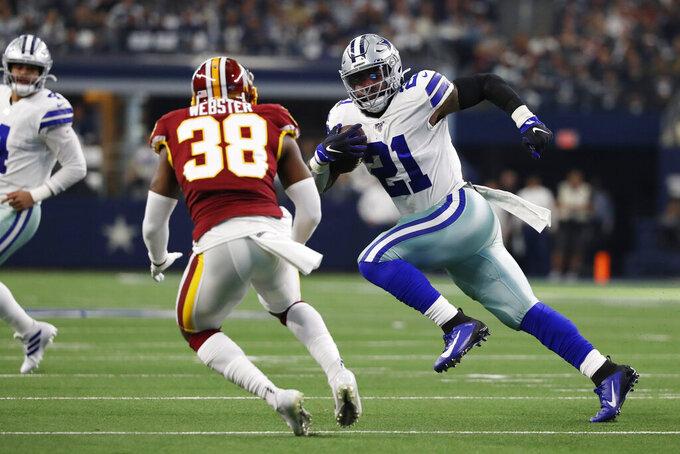 Dallas Cowboys running back Ezekiel Elliott (21) runs past Washington Redskins defensive back Kayvon Webster (38) during the first half of an NFL football game in Arlington, Texas, Sunday, Dec. 15, 2019. (AP Photo/Roger Steinman)