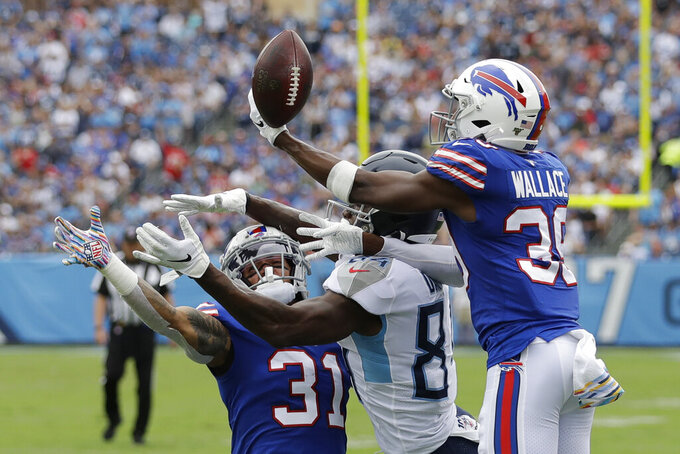 Buffalo Bills defensive back Levi Wallace (39) and strong safety Dean Marlowe (31) break up a pass intended for Tennessee Titans wide receiver Corey Davis (84) in the first half of an NFL football game Sunday, Oct. 6, 2019, in Nashville, Tenn. (AP Photo/James Kenney)