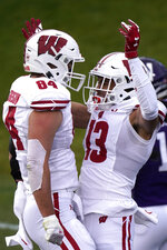 Wisconsin wide receiver Chimere Dike, right, celebrates with tight end Jake Ferguson after scoring touchdown during the first half of an NCAA college football game against Northwestern in Evanston, Ill., Saturday, Nov. 21, 2020. (AP Photo/Nam Y. Huh)