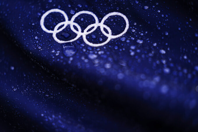 FILE - In this Aug. 7, 2021, file photo, raindrops collect on Olympic Rings ahead of the bronze medal baseball game between Dominican Republic and South Korea at the 2020 Summer Olympics, in Yokohama, Japan. (AP Photo/Matt Slocum, File)