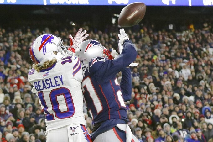 New England Patriots defensive back J.C. Jackson, right, breaks up a pass in the end zone intended for Buffalo Bills wide receiver Cole Beasley in the second half of an NFL football game, Saturday, Dec. 21, 2019, in Foxborough, Mass. (AP Photo/Bill Sikes)