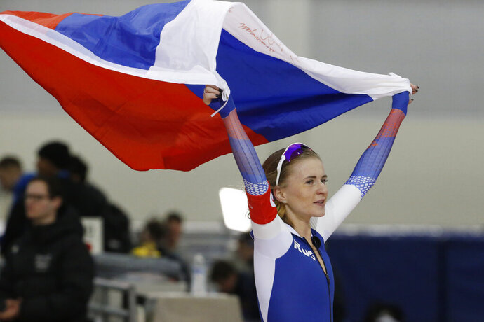 Russia's Natalia Voronina celebrates after competing in the women's 5,000 meters during the world single distances speedskating championships Saturday, Feb. 15, 2020, in Kearns, Utah. (AP Photo/Rick Bowmer)
